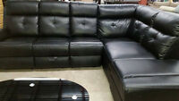 black leather style sectional with attachable ottoman