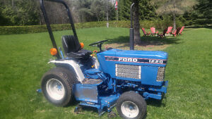 Ford 1220 tractor....lawnmower..tiller..snowblower