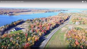 Wooded waterfront lots for sale in Grand Barachois