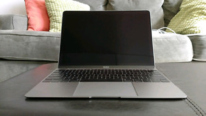 Barely touched Macbook for sale!