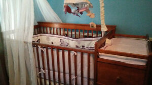 Baby crib with attached dresser, change table and under crib sto