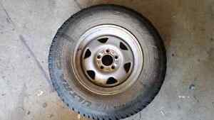Jeep Wheel And Studded Tire For Sale Or Trade