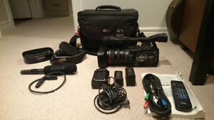 Canon XH-A1 Camcorder, 2 batteries, RODE mic, Lowepro bag + More