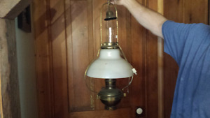 Two old hanging brass lamps