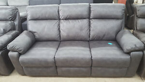 Gray reclining couch - delivery available