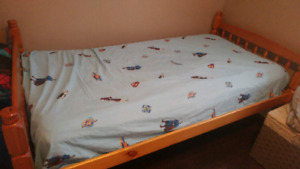 2 single beds with mattrresses and mattress covers