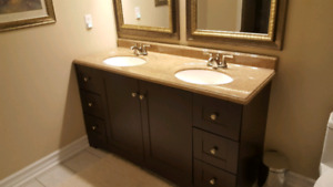 His and hers vanity, cabinet, mirrors and lighting
