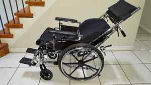 Reclining and Foldable Wheelchair with Elevated Foot Rest
