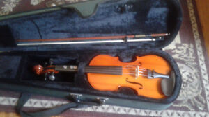 Child size violin with bow and case