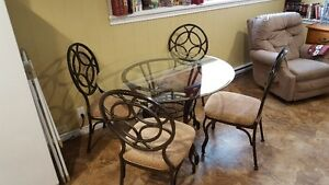 Round, Glass top dinning table and 4 chairs