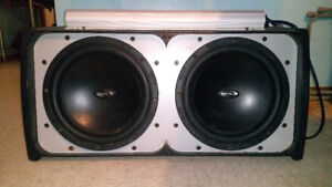 Enclosed Realm 2-12 inch subwoofers with 2000 watt Amp...