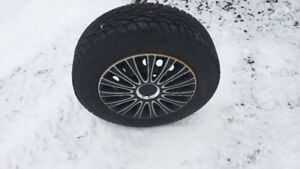 4- 15inch steel wheels and new UnaRoyal snow tires