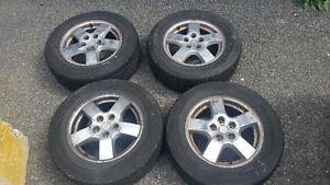 4 mag et pneu 215/65/16 Dodge Caravan