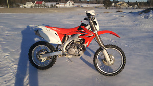 Honda crf450x showroom  trade or cash