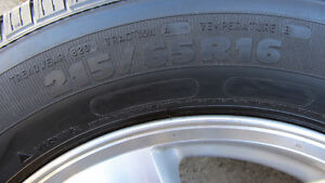 215/65R16 Michelin Defender with Dodge alloy rims