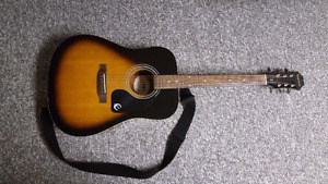 Used Epiphone acoustic guitar with electric pickup