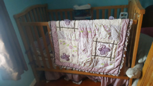 Wooden crib with matress and girl baby bedding
