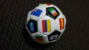 Brand new soccer ball with world flags