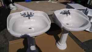 Pedestal sinks with taps