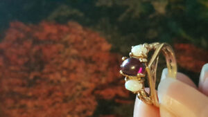 Opal and garnet ring