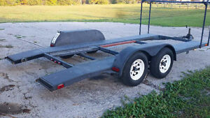 16' beavertail open Trailer with tire rack.