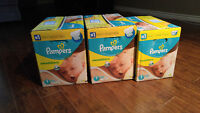 3 boîtes de couches Pampers Swaddlers gr. 1