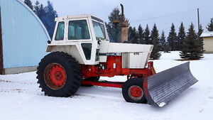 Tractor with blade