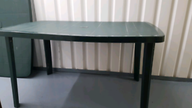 USED GREEN PLASTIC GARDEN TABLE IN GOOD CONDITION