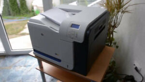 HP Color LaserJet CP3525X with 4 FULL CARTRIDGES
