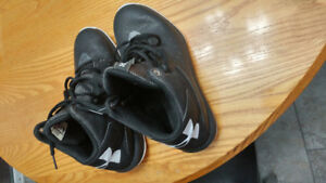 Under Armour high top basketball shoes.