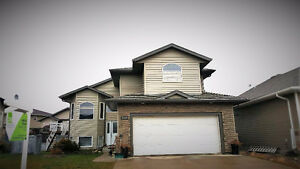 Open concept 6 bedroom home located close to school