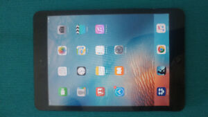 Ipad Mini 1st Generation 16GB Model with Bluetooth Headphones