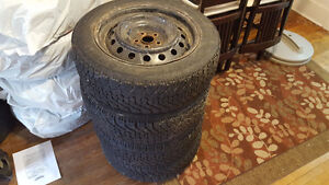 GoodYear Nordic Winter tires on steel rims.