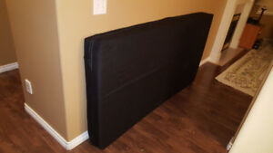 Twin foam mattress with black zippered cover