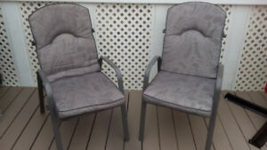 Patio chairs with high back cushions. Like new.  Set of 4.