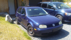 2004  volkswagon golf standard with studded snow tires on rims