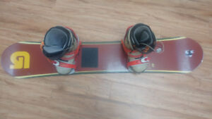 Women's Limited snowboard with boots (size 8.5 US)