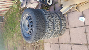 Set 4 1 season old winter tires 185 65R 14