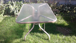 Glass top rectangular table with 4 chairs