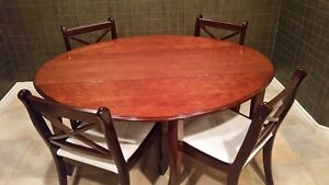 cherrywood dining table and four chairs