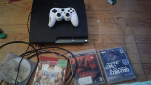ps3 wih 4 game doscs and 4 on system