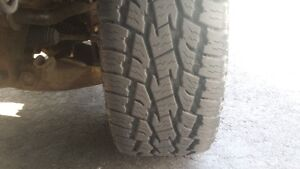 jeep 4 toyo A/T tires on four 18 inch alloys $800.00.