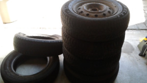 4 winter tires with rims and 2 summer tires