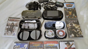 2 - Older PSP 1000 - with cases and games