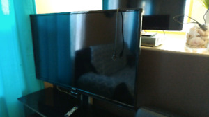 "RCA 55"" LED TV and Tv stand W-47 D-20 H 38"""