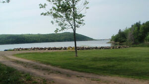 Waterfront property - cleared, landscaped, & ready to build!