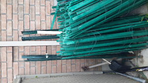 Green wood fencing with metal poles  400 linear ft 4ft high