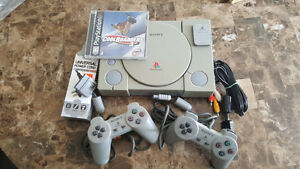 playstation 1 with hook ups, 2 controllers, memory card & game