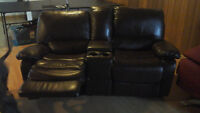Leather love seat and couch both reclining
