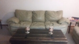 Beige leather couch and loveseat open to offers